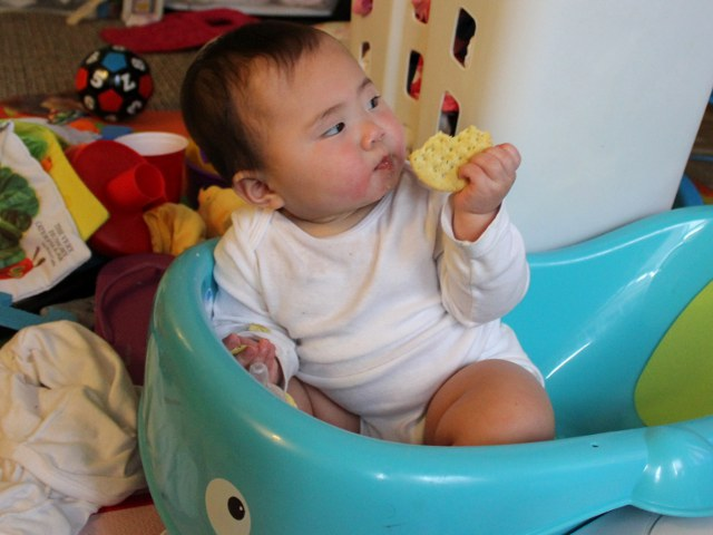 Baby Eating in a Tub