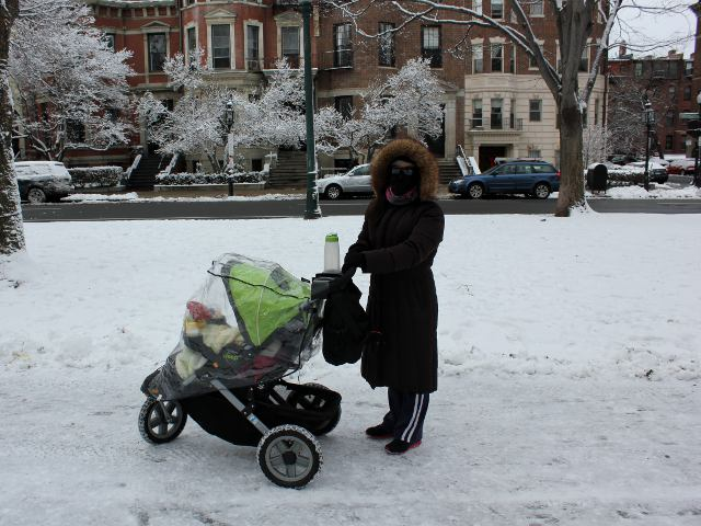 Pushing Baby Stroller Through Snow